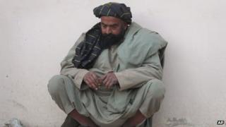 Man waits at Kandahar hospital for news of injured relative