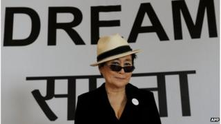 Yoko Ono, poses for photographers during a press conference in New Delhi on January 11, 2012.
