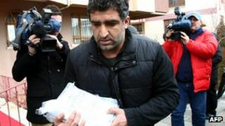 Turkish security officials pictured leaving the house of prominent Kurdish politician Leyla Zana