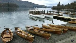 Rowing boats line the banks of Lake Windermere