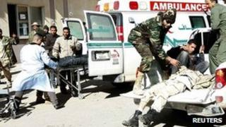 Medics prepare to carry wounded fighters to hospital in Gharyan. Photo: 14 January 2012