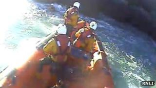 St Catherine's lifeboat crew rescuing a kayaker