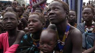 Labakal Kalahin cradles her 18-month-old baby