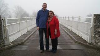 Grahame Penny and Maggie Taylor on Whitney-on-Wye toll bridge