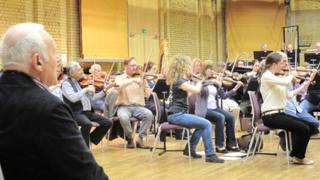 Sir Anthony Hopkins watches the City of Birmingham Symphony Orchestra rehearse