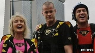 Jeb Corliss, centre, with fellow base jumpers in Singapore 1 January 2012