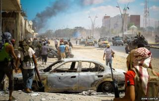 Rebel gun trucks in Sirte, Libya, in September 2011 - photo by John Cantlie