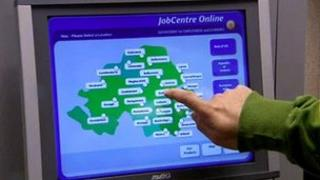 Person tapping jobcentre touch screen