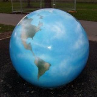 Concrete sculpture of Earth