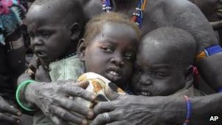 Victims of ethnic violence in Jonglei, South Sudan, wait in Pibor to receive emergency food rations, 12 January 2012