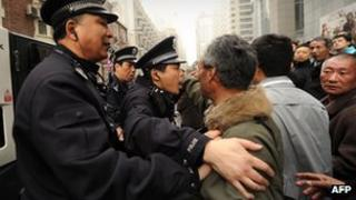 Shanghai police disperse crowd in February 2011