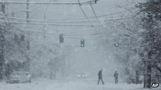 Pedestrians walking through the snow, Seattle 15 January 2012