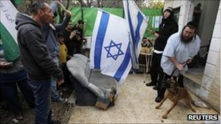 Jewish settlers argue with protesters in front of their house in the Sheikh Jarrah neighborhood of East Jerusalem.