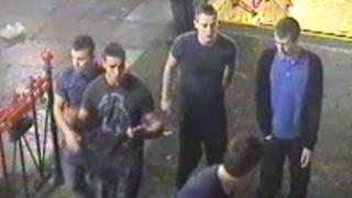 CCTV image of men