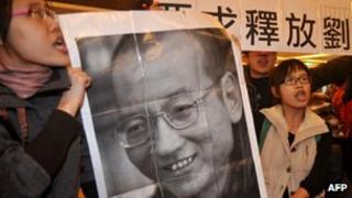 Demonstrators hold a portrait of China's detained Nobel Peace Prize winner Liu Xiaobo demanding his immediate release during a protest in Taipei, Taiwan, on 20 December 2010