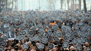 "Marchers carry placards reading ""We are all Hrant, we are all Armenian"" in Istanbul, 19 January"
