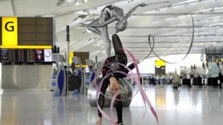 Frankie Jones and the sculpture at Heathrow