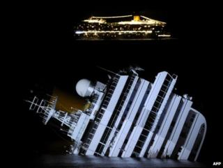 The Costa Serena cruise ship (background) passes the wreck of its sister ship, the Costa Concordia, off Giglio, Italy, 18 January