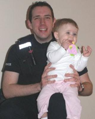 PC Tristan Barnett with Amelia