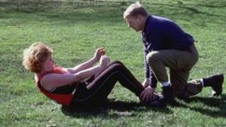 Personal trainer takes client through her paces