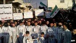 Grab of video purportedly showing opposition activists dress as prisoners in protest in the city of Idlib at the detention of thousands of people during the Syrian uprising (20 January 2012)