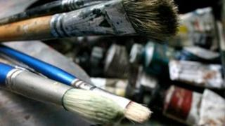 Artist's brushes and paint