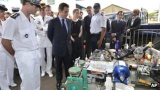 President Nicolas Sarkozy inspects equipment seized from illegal gold diggers in French Guiana
