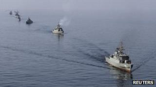 Iranian naval ships take part in a naval parade in the Sea of Oman near the Strait of Hormuz