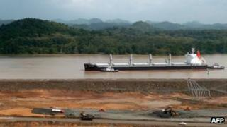 A ship in the Panama Canal going past the construction site