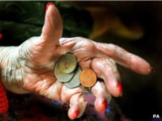 Elderly hand holding money