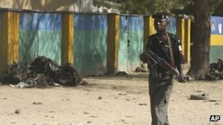 Nigerian soldier on patrol near site of Friday's suicide bombing (24 January)