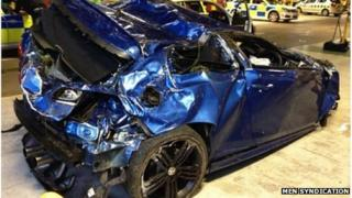 Damaged Greater Manchester Police car
