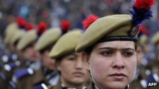 Members of the Jammu and Kashmir Armed Police march during a Republic Day parade at the Bakshi stadium in Srinagar on 26 January 2012