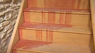 Cement additive on stairs at arson attack house in Camelford