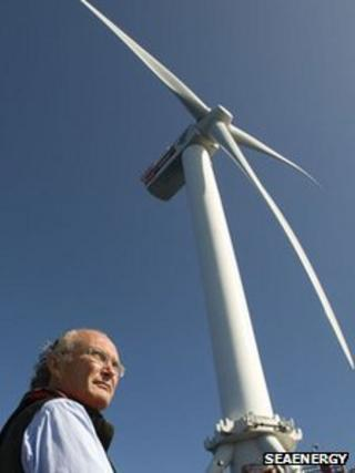 Steve Remp pictured standing in front of wind turbine
