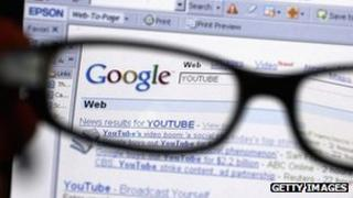 Glasses over a monitor showing Google search