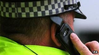 A police officer using a mobile phone