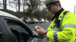 Policeman at car