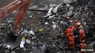 Rescuers remove the body of a victim from the rubble of a collapsed building in Rio de Janeiro