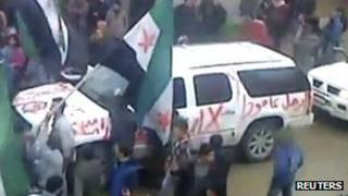 """A photo purportedly showing graffiti on an Arab League observer vehicle reading """"Leave"""" in Syria"""