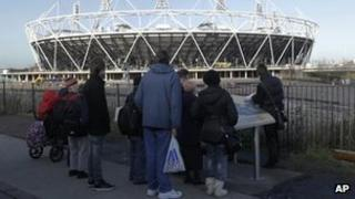 People looking at the Olympic Stadium in London