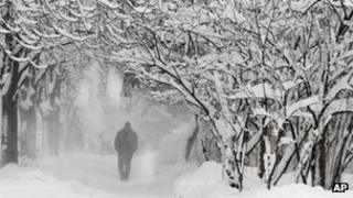 Man walks in snowy conditions in Sofia, Bulgaria, on 26 January 2012