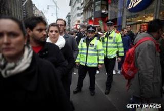 Police patrol shopping street