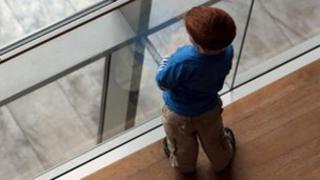 Child at window