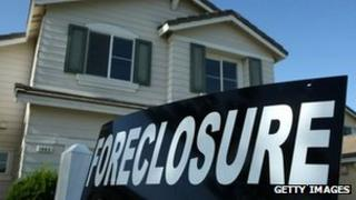 A foreclosure (repossession) sign in front of a house