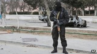 Kazakh riot police officer patrols in centre of Zhanaozen, Kazakhstan (17 Dec 2011)