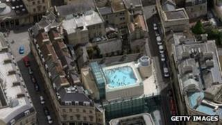 People swim in the roof top pool of the Thermae Bath Spa in the centre of Bath
