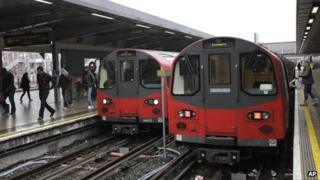 Commuters and Jubilee Line Tube trains at Stratford, east London, 18 January 2012