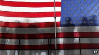 American flag with silhouettes
