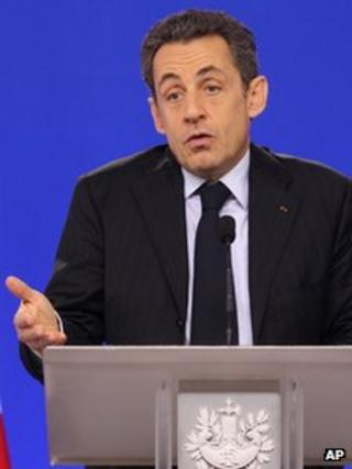 French President Nicolas Sarkozy addresses the media during an EU summit at the European Council building in Brussels, Monday, Jan. 30, 2012